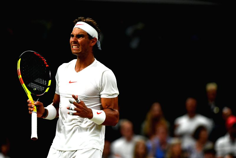 LONDON, July 14, 2018 - Rafael Nadal of Spain reacts during the men's singles semifinal match against Novak Djokovic of Serbia at the Wimbledon Championships 2018 in London, Britain, on July 13, ...