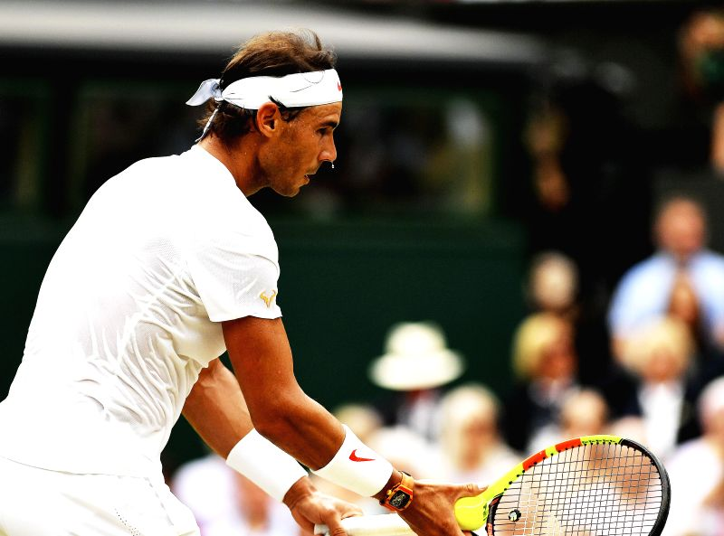 LONDON, July 14, 2018 - Rafael Nadal of Spain serves during the men's singles semifinal match against Novak Djokovic of Serbia at the Wimbledon Championships 2018 in London, Britain, on July 13, ...