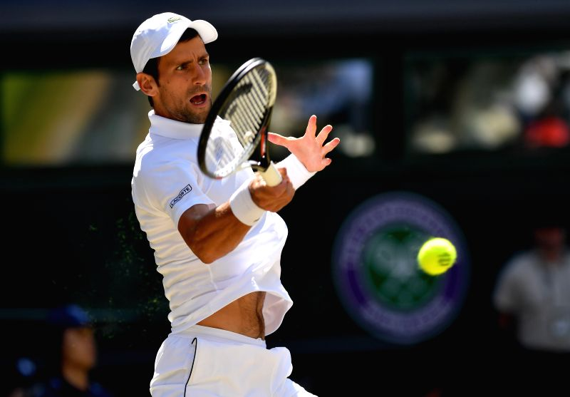 LONDON, July 15, 2018 - Novak Djokovic of Serbia hits a return during the men's singles final match against Kevin Anderson of South Africa at the Wimbledon Championships 2018 in London, Britain, on ...