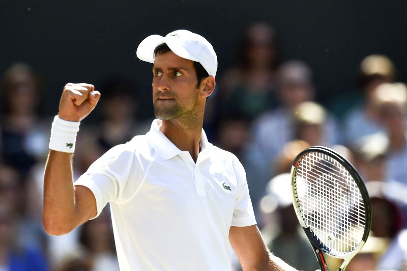 LONDON, July 16, 2018 - Novak Djokovic of Serbia reacts during the men's singles final match against Kevin Anderson of South Africa at the Wimbledon Championships 2018 in London, Britain, on July 15, ...