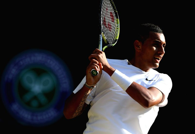 Australia's Nick Kyrgios returns the ball during the men's singles fourth round match against Spain's Rafael Nadal at the 2014 Wimbledon Championships in Wimbledon, ..