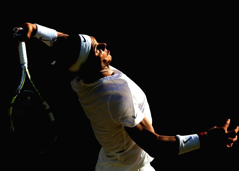 Spain's Rafael Nadal serves the ball during the men's singles fourth round match against Australia's Nick Kyrgios at the 2014 Wimbledon Championships in Wimbledon, ...