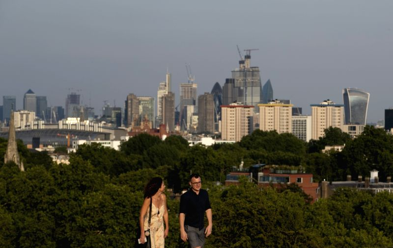 LONDON, July 27, 2018 - People walk in a park in London, Britain on July 26, 2018. Temperatures in the coming days could break all-time UK records, with the mercury set to soar to 37 degree Celsius, ...