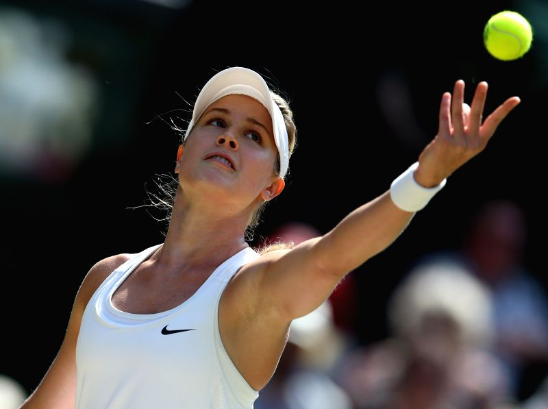 Eugenie Bouchard of Canada serves during the women's singles semi final against Simona Halep of Romania at the 2014 Wimbledon Championships in Wimbledon, southwest ...