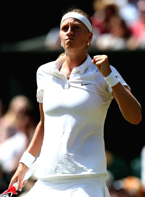 Petra Kvitova of Czech Republic celebrates during the women's singles semi final against her compatriot Lucie Safarova at the 2014 Wimbledon Championships in ...