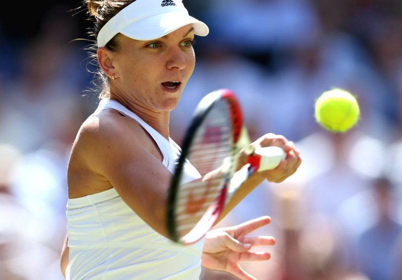 Simona Halep of Romania returns a shot during the women's singles semi final against Eugenie Bouchard of Canada at the 2014 Wimbledon Championships in Wimbledon, ...