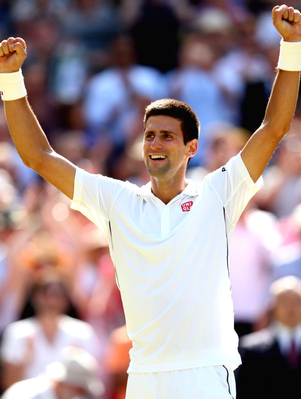Serbia's Novak Djokovic celebrates after winning the men's singles semi-final match against Bulgaria's Grigor Dimitrov at the 2014 Wimbledon Championships in ...