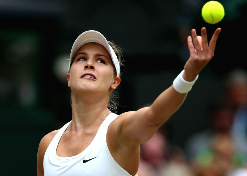 Canada's Eugenie Bouchard serves the ball during the women's singles final match against Czech Republic's Petra Kvitova at the 2014 Wimbledon Championships in ...
