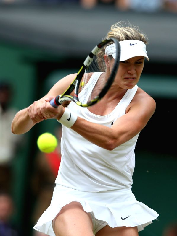 Canada's Eugenie Bouchard returns the ball during the women's singles final match against Czech Republic's Petra Kvitova at the 2014 Wimbledon Championships in ...