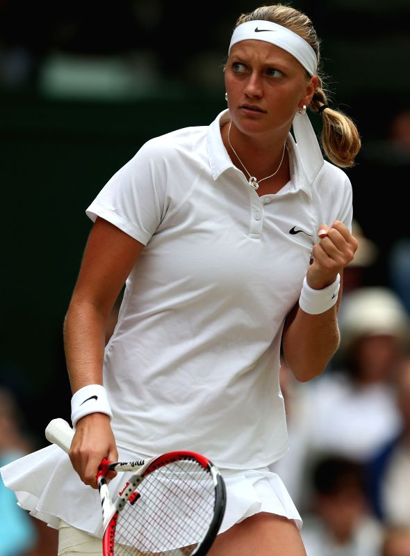 Czech Republic's Petra Kvitova celebrates during the women's singles final match against Canada's Eugenie Bouchard at the 2014 Wimbledon Championships in Wimbledon, ..