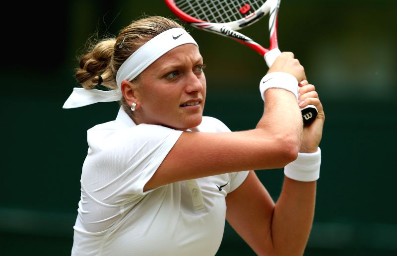 Czech Republic's Petra Kvitova returns the ball during the women's singles final match against Canada's Eugenie Bouchard at the 2014 Wimbledon Championships in ...
