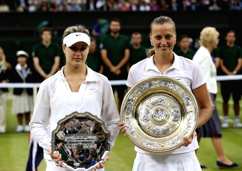 Czech Republic's Petra Kvitova (front R) and Canada's Eugenie Bouchard pose with their trophies during the award ceremony after the women's singles final match at the