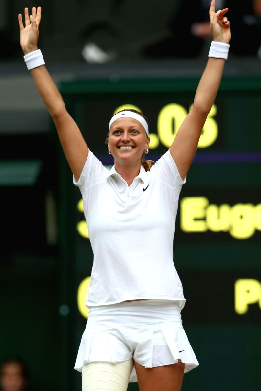 Czech Republic's Petra Kvitova celebrates after the women's singles final match against Canada's Eugenie Bouchard at the 2014 Wimbledon Championships in Wimbledon, ...