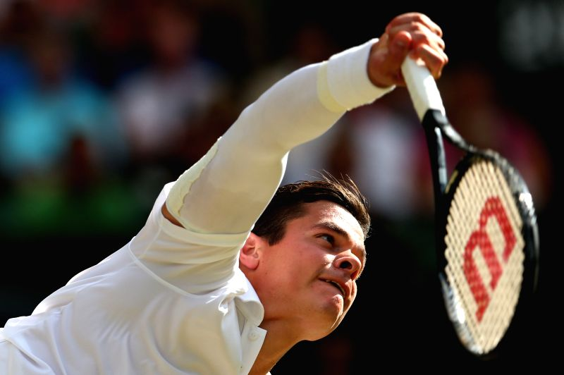 Milos Raonic of Canada competes during the men's singles semifinal match against Roger Federer of Switzerland at the All England Lawn Tennis Championships in ...