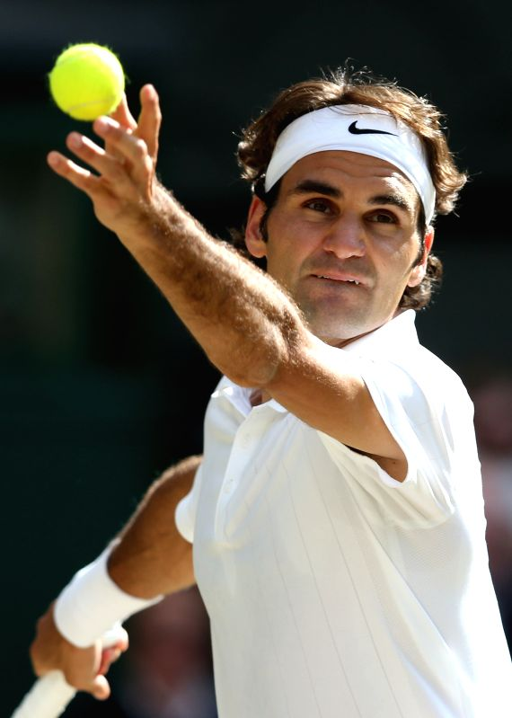 Roger Federer of Switzerland competes the men's singles semifinal match against Milos Raonic of Canada at the All England Lawn Tennis Championships in Wimbledon, ...