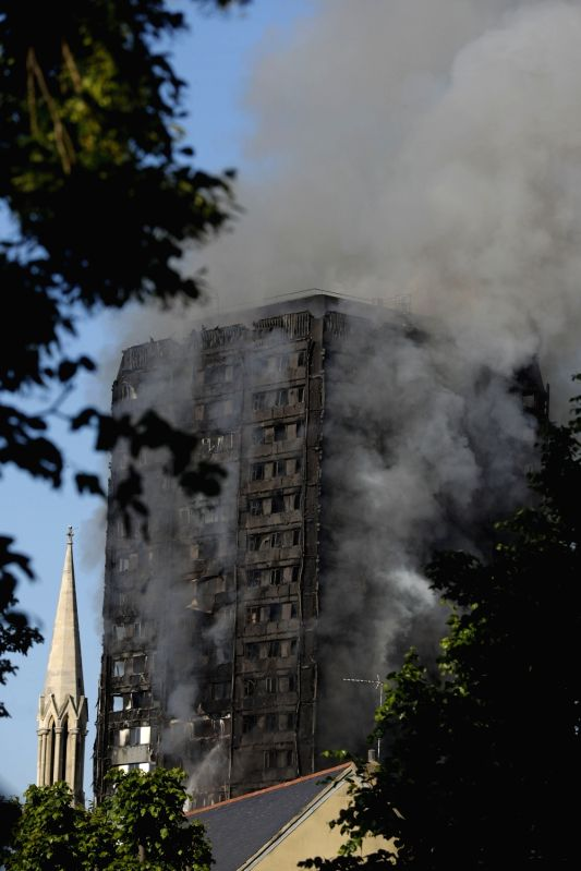 LONDON, June 14, 2017 - An apartment building is engulfed by a massive fire in western London, Britain, June 14, 2017. A massive fire engulfed a 27-story apartment building in western London early ...