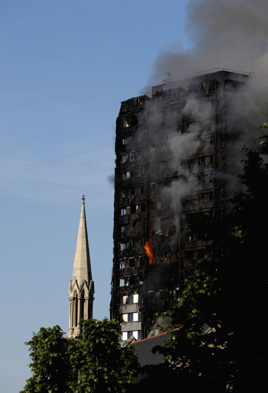 LONDON, June 14, 2017 - An apartment building is engulfed by a massive fire in western London, Britain, June 14, 2017. A massive fire engulfed a 27-story apartment building in west London early ...