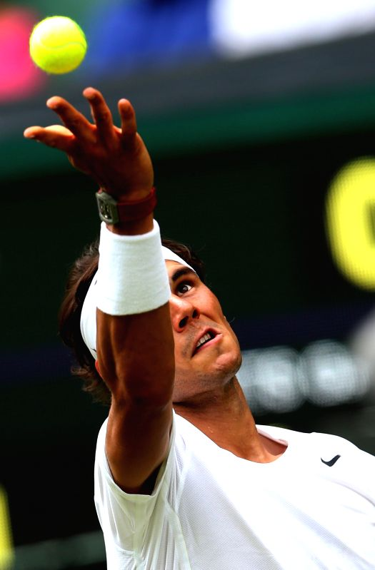 Spain's Rafael Nadal serves to Slovakia's Martin Klizan during their men's singles first round match at the 2014 Wimbledon Championships in London, Britain, on June .