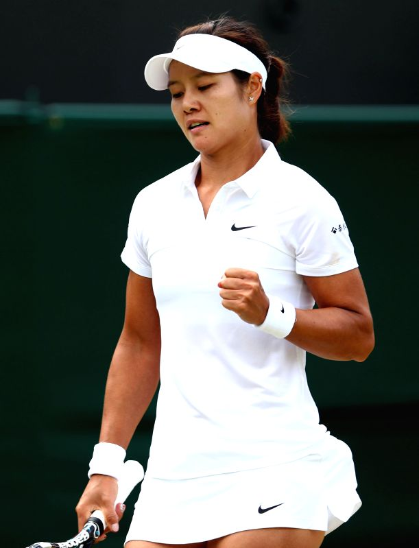 China's Li Na celebrates during the women's singles second round match against Austria's Yvonne Meusburger at the 2014 Wimbledon Championships in Wimbledon, ...