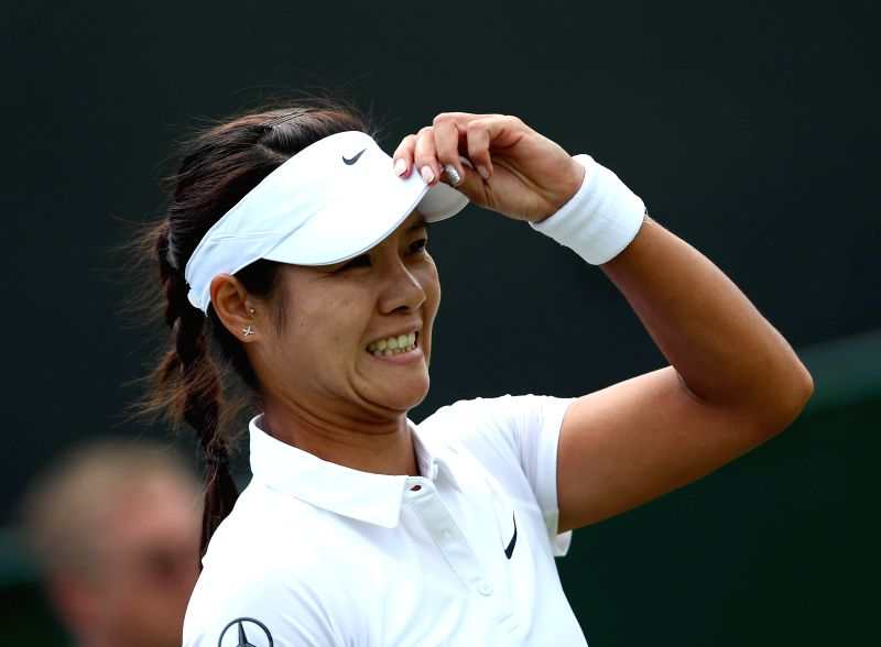 China's Li Na gestures during the women's singles second round match against Austria's Yvonne Meusburger at the 2014 Wimbledon Championships in Wimbledon, southwest .