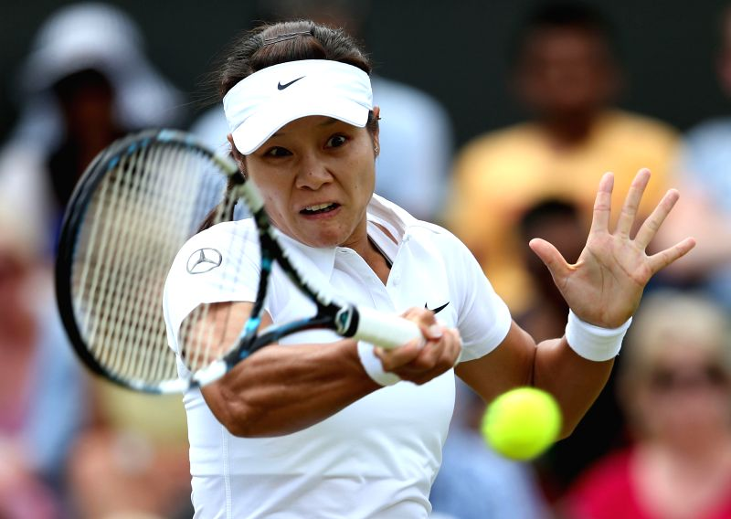 China's Li Na returns the ball during the women's singles second round match against Austria's Yvonne Meusburger at the 2014 Wimbledon Championships in Wimbledon, ...