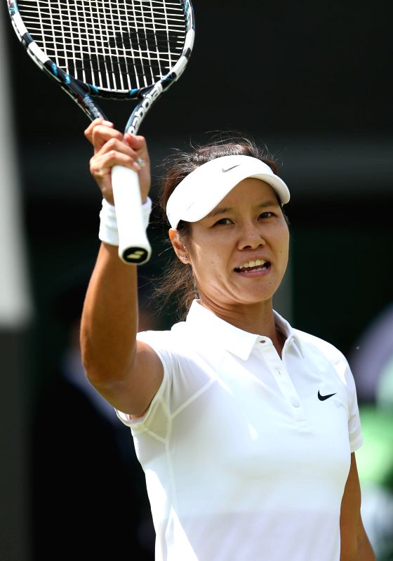 China's Li Na waves to the crowd after the women's singles second round match against Austria's Yvonne Meusburger at the 2014 Wimbledon Championships in Wimbledon, ..