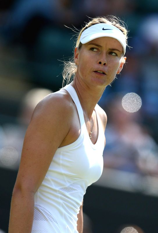 Maria Sharapova of Russia competes during the women's singles first round match against Samantha Murray of Britain at the 2014 Wimbledon Championships in London, ...