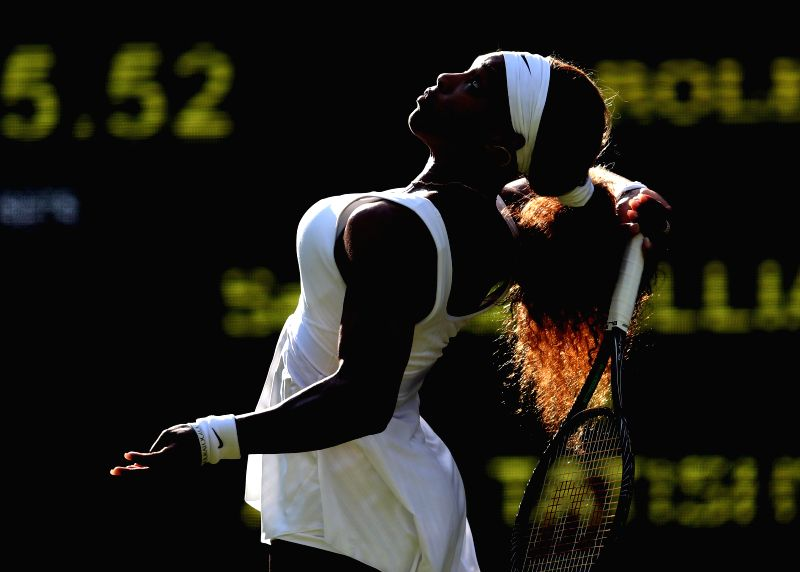 Serena Williams of the United States competes during the women's singles first round match against compatriot Anna Tatishvili at the 2014 Wimbledon Championships in .
