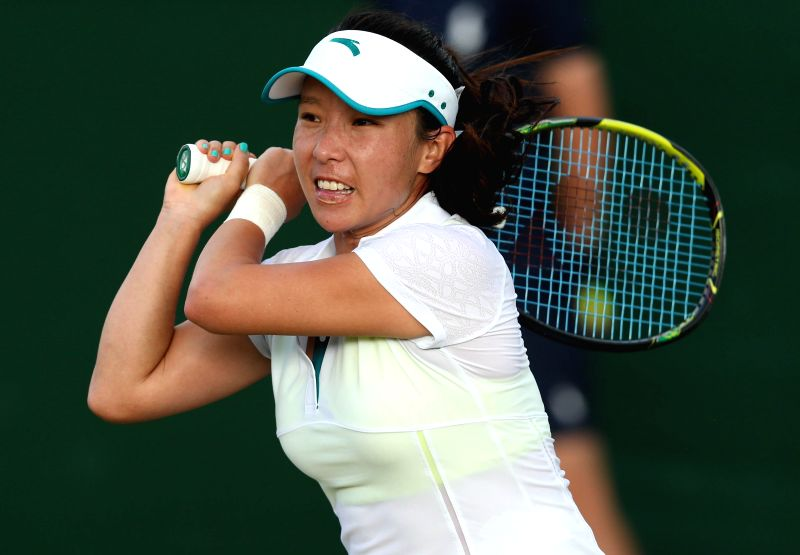 Zheng Jie of China competes during the women's singles first round match against Annika Beck of Germany at the 2014 Wimbledon Championships in London, Britain, on ...