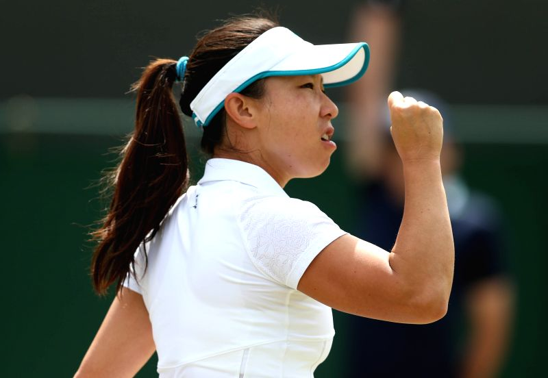 China's Zheng Jie celebrates during the women's singles second round match against Serbia's Ana Ivanovic at the 2014 Wimbledon Championships in Wimbledon, southwest .