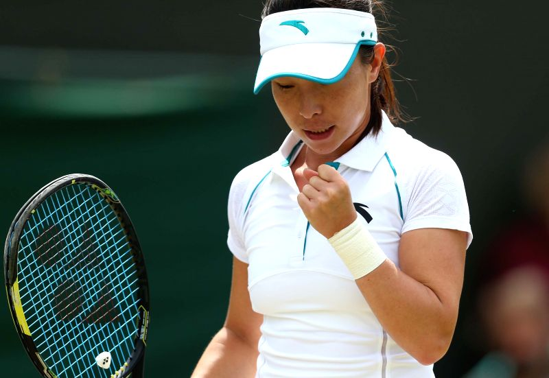 China's Zheng Jie reacts during the women's singles second round match against Serbia's Ana Ivanovic at the 2014 Wimbledon Championships in Wimbledon, southwest ...