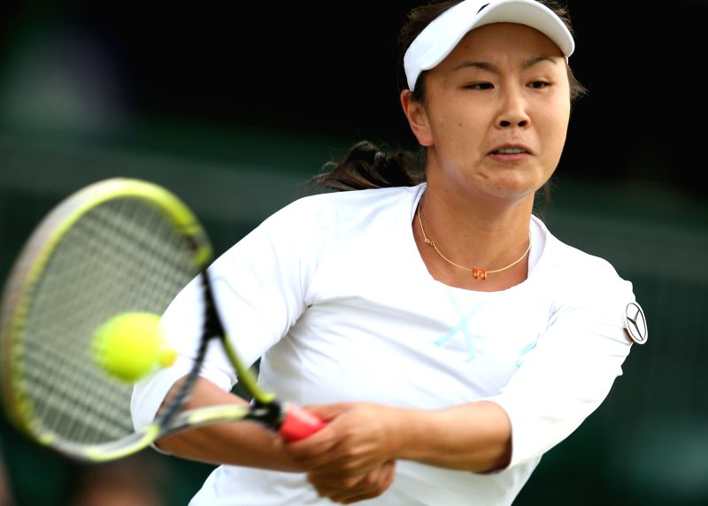 Peng Shuai of China competes during the women's singles second round match against Maria Kirilenko of Russia at the 2014 Wimbledon Championships in Wimbledon, ...