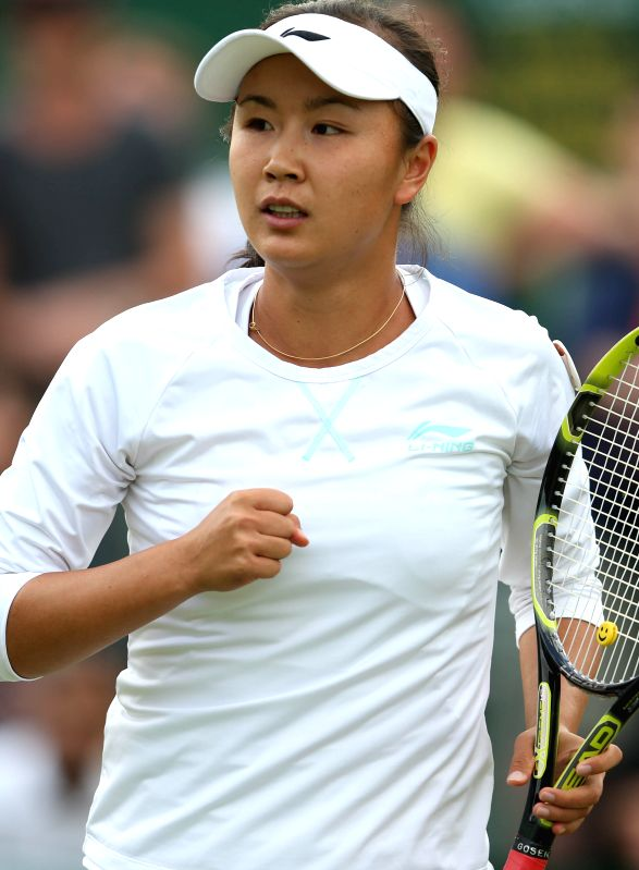 Peng Shuai of China celebrates during the women's singles second round match against Maria Kirilenko of Russia at the 2014 Wimbledon Championships in Wimbledon, ...