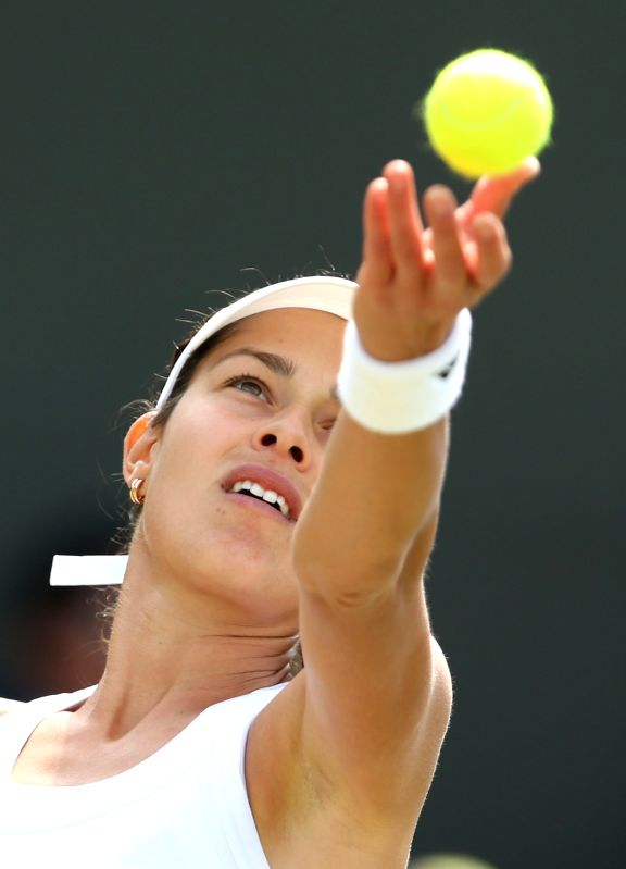 Serbia's Ana Ivanovic serves during the women's singles second round match against China's Zheng Jie at the 2014 Wimbledon Championships in Wimbledon, southwest ...