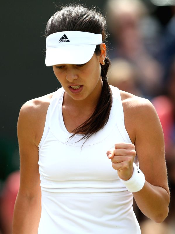 Serbia's Ana Ivanovic celebrates during the women's singles second round match against China's Zheng Jie at the 2014 Wimbledon Championships in Wimbledon, southwest .