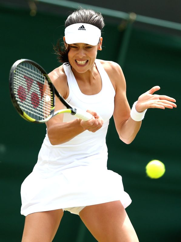 Serbia's Ana Ivanovic returns the ball during the women's singles second round match against China's Zheng Jie at the 2014 Wimbledon Championships in Wimbledon, ...