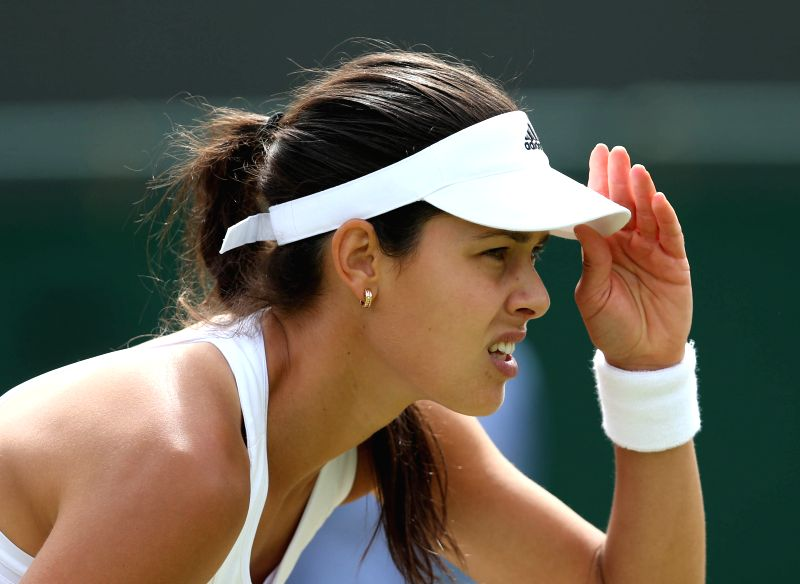 Serbia's Ana Ivanovic gestures during the women's singles second round match against China's Zheng Jie at the 2014 Wimbledon Championships in Wimbledon, southwest ...