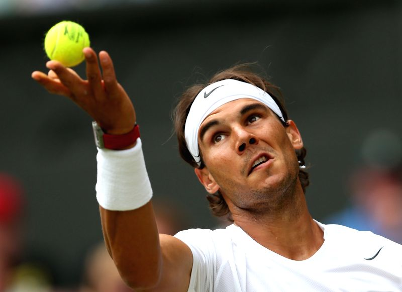 Spain's Rafael Nadal serves during the men's singles second round match against Czech Republic's Lukas Rosol at the 2014 Wimbledon Championships at Wimbledon, ...