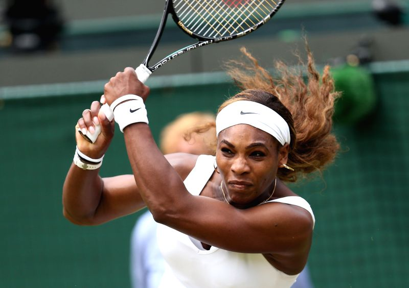 U.S. player Serena Williams returns the ball during the women's singles second round match against South Africa's Chanelle Scheepers at the 2014 Wimbledon ...