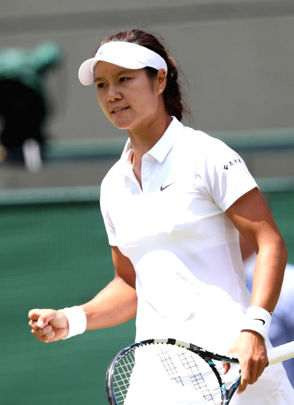 China's Li Na celebrates during the women's singles third round match against Czech Republic's Barbora Zahlavova Strycova at the 2014 Wimbledon Championships at ...