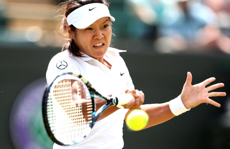 China's Li Na returns a shot during the women's singles third round match against Czech Republic's Barbora Zahlavova Strycova at the 2014 Wimbledon Championships at .