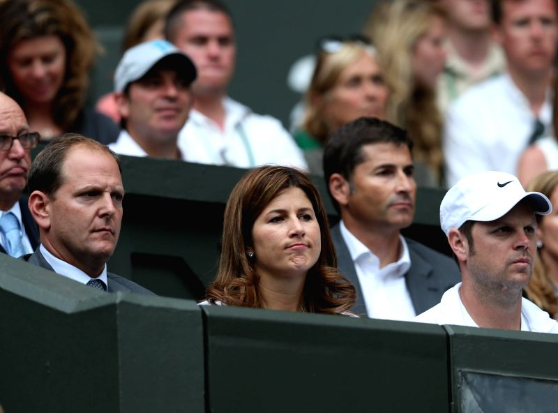 Mirka Federer (C Front), wife of Switzerland's Roger Federer, watch the match between Roger Federer and Luxembourg's Gilles Muller during the men's singles second ...