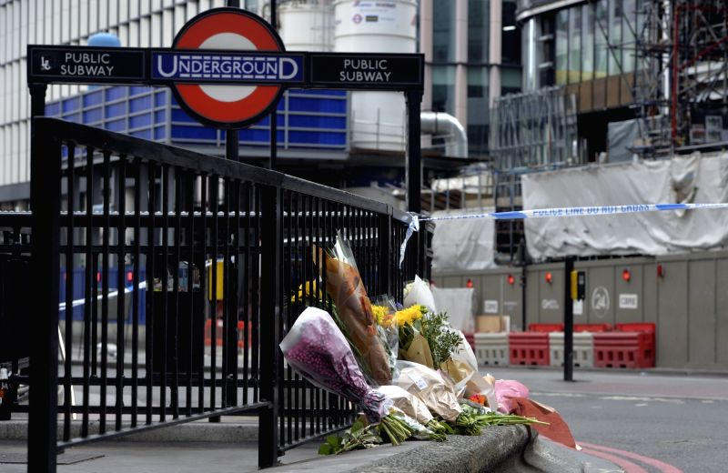 LONDON, June 4, 2017 - Flowers are placed to pay respect to the victims of Saturday's terror attack at the north entrance of London Bridge underground Station in London, Britain on June 4, 2017. ...