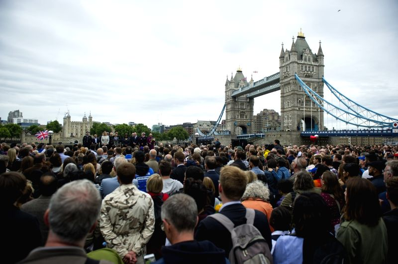 LONDON, June 5, 2017 - People take part in a mourning for the victims of the London Bridge attack in London, Britain, on June 5, 2017. The London Bridge attack occured on Saturday claimed seven lives ...