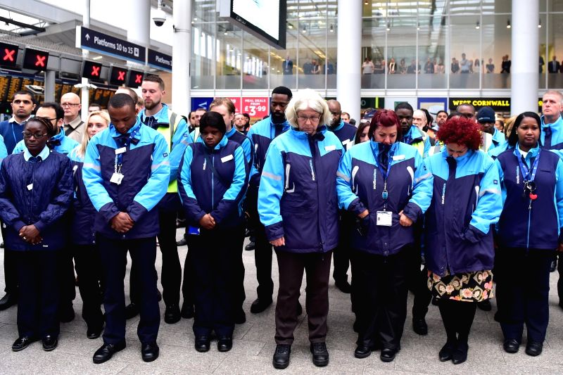 LONDON, June 6, 2017 - Station staff members hold a minute's silence at London Bridge Station for the victims of the attack on London Bridge in London, Britain, on June 6, 2017. Seven people died and ...