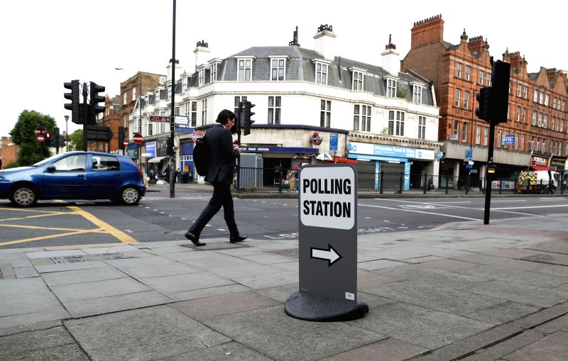 LONDON, June 8, 2017 - A man passes by a polling station in London, Britain, on June 8, 2017. Polling stations across the Britain opened early Thursday as voters started to make their decision in the ...