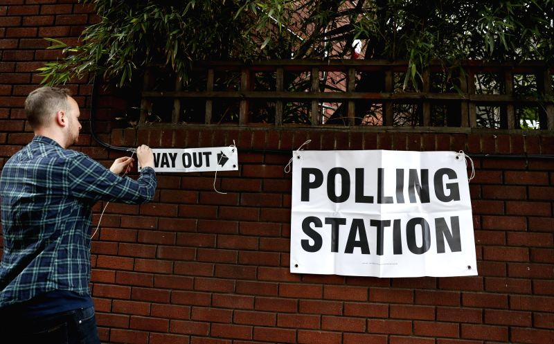 LONDON, June 8, 2017 - A staff works outside a polling station in London, Britain on June 8, 2017. Polling stations across the Britain opened early Thursday as voters started to make their decision ...