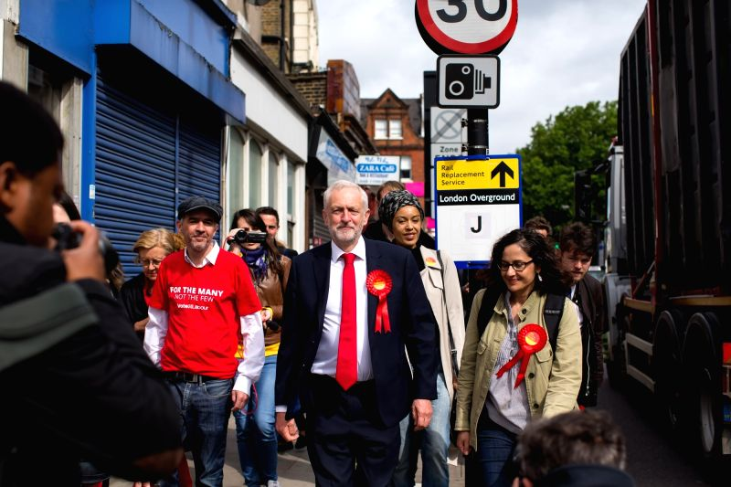LONDON, June 8, 2017 - er of Britain's main opposition Labour Party Jeremy Corbyn (Front C) walks to the polling station in London, Britain on June 8, 2017.