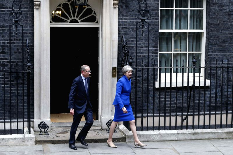 LONDON, June 9, 2017 - British Prime Minister Theresa May (R) and her husband leave the 10 Downing Street to visit Buckingham Palace in London, Britain on June 9, 2017. Theresa May will visit ... - Theresa May
