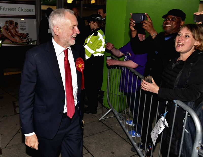 LONDON, June 9, 2017 - Labour Party leader Jeremy Corbyn (L) leaves the count center after being re-elected in the London Islington North constituency, in Islington, London, Britain on June 9, 2017. ...